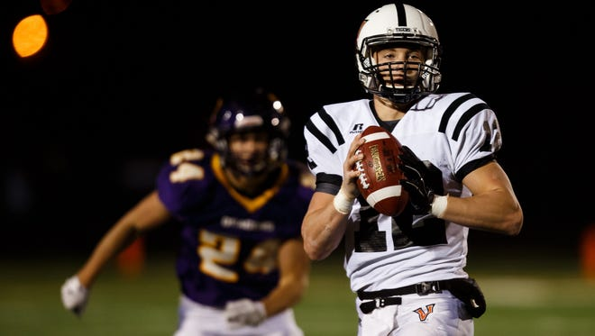 Valley's Rocky Lombardi looks for a pass during their quarterfinal game at Johnston on Friday, November 06, 2015 in Johnston.