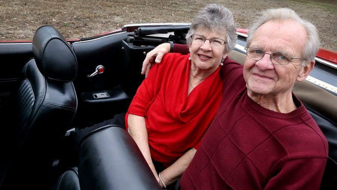 Tom and Barbara Collins in the backseat of their 1969 mustang on Wednesday, Jan. 25, 2017.