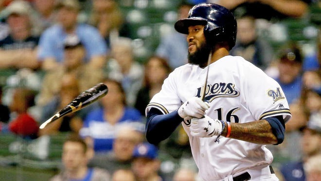 Domingo Santana of the Brewers breaks his bat during a line out in the seventh inning against the Cardinals at Miller Park.