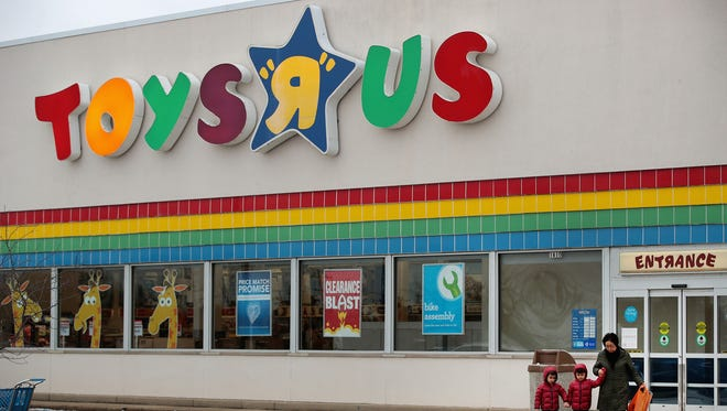 Customers shop at a Toys R Us store on Jan. 24, 2018, in Highland Park, Ill. The store is one of the approximately 170 stores that is closing in the U.S. Store-closing sales began Wednesday, Feb. 7, 2018.