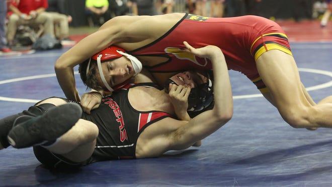 Carlisle's Carter Logue wrestles Cedar Falls' Jackson Barth in the Class 3A state meet last season. Logue won the PCM Mustang Invitational 126-pound title on Jan. 5.