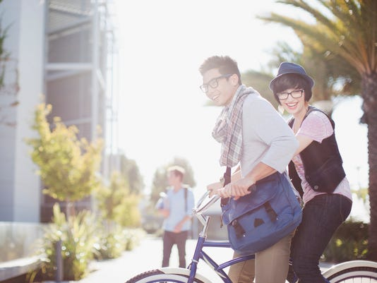 Couple riding bicycle together