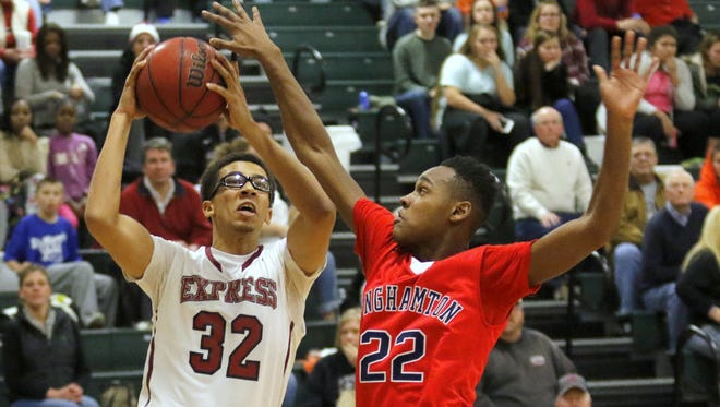 Elmira's Jadakis Brooks drives to the basket while defended by Binghamton's Jaquan Pinckney during a game Jan. 8 at Elmira.