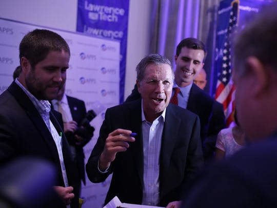 Ohio gov. John Kasich, a Republican candidate for president, speaks with supporters following a round table event on Monday August 31, 2015 at the University Technology Center on the Lawrence Tech University campus in Southfield.