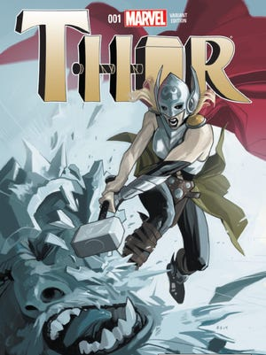 """A woman wields the mystical hammer Mjolnir in Marvel Comics' relaunched """"Thor"""" comic book."""