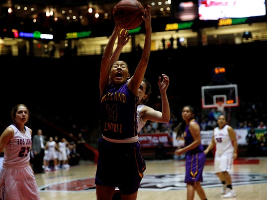 Kirtland Central's Shayonna Begay grabs a defensive rebound against Los Lunas during Thursday's 5A state semifinals in Albuquerque. Visit daily-times.com to see video highlights.