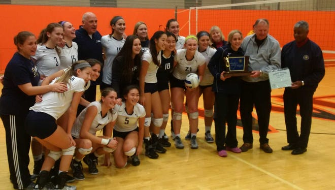 The NV/Old Tappan girls volleyball team celebrating its second consecutive State Tournament of Champions title at the William Paterson Rec Center on Sunday, Nov. 20, 2016.