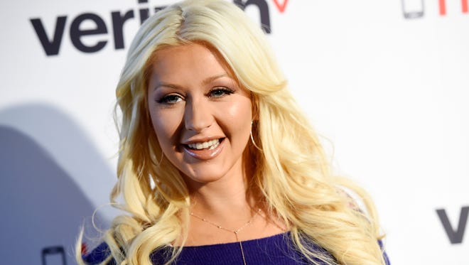 Singer Christina Aguilera poses at an event supporting Hopeline From Verizon, a new campaign supporting domestic violence prevention and awareness, at The London Hotel on Thursday, Nov. 12, 2015, in West Hollywood, Calif. (Photo by Chris Pizzello/Invision/AP)