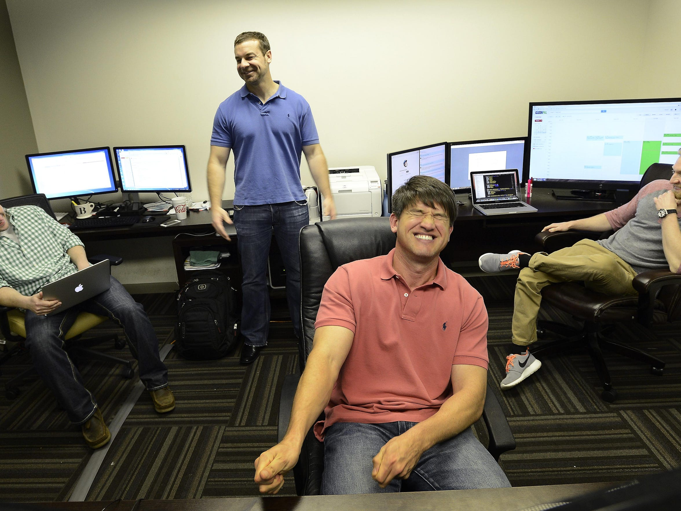 GreenPal CEO Bryan Clayton with co-founders, Ross Brooks, left, Gene Caballero, front, and Zach Hendrix.