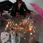 People honor Amanda after her suicide in 2012.