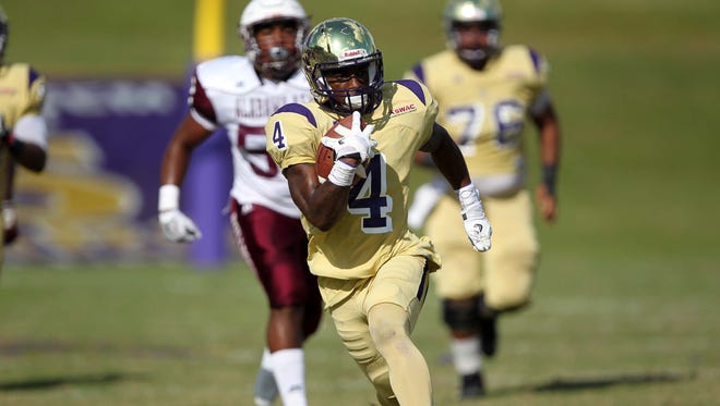 Junior P.J. Simmons breaks one of his several long runs Saturday during his 173-yard performance as Alcorn State beat Alabama A&M 47-22.