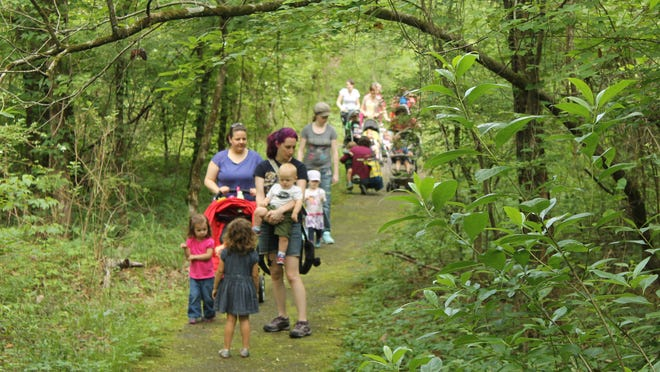 Families walk through Walter B. Jacobs Nature Park.