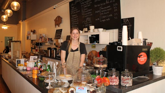 Catherine Heaney, owner and operator of Char-cu-te-rie in Downtown Visalia stands by the espresso machine and an array of cookies.