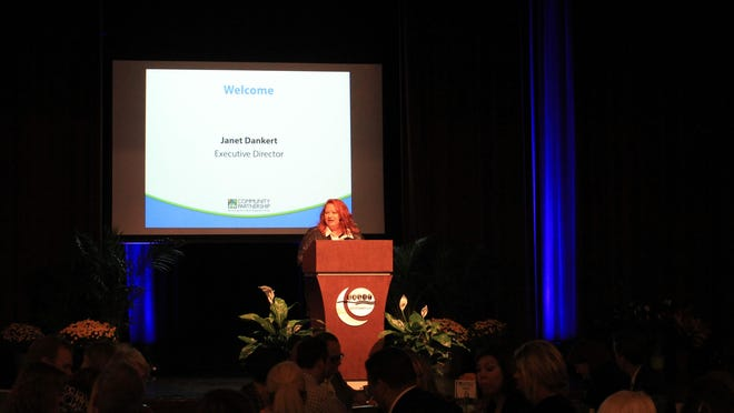 Janet Dankert, executive director of Community Partnership of the Ozarks, speaks Monday at the group's annual meeting.