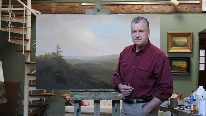 Artist Scott Balfe is shown in his studio.