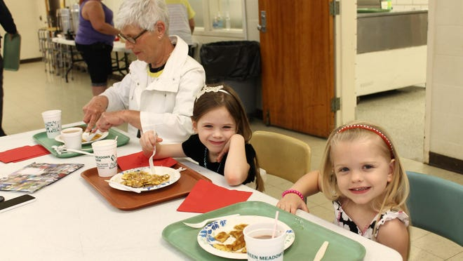 Dee, Evann and Ila McElfresh enjoy a previous pancake breakfast at Notre Dame Academy. This year's breakfast is Feb. 21.