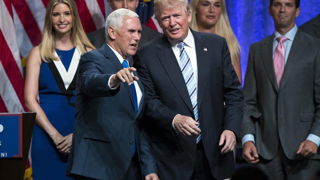 Republican presidential candidate Donald Trump, right, talks with Gov. Mike Pence, R-Ind., during a campaign event to announce Pence as the vice presidential running mate on, Saturday, July 16, 2016, in New York. In their first joint appearance, Trump tried to draw a sharp contrast between Pence, a soft-spoken conservative, and Hillary Clinton, the Democratic presidential candidate. (AP Photo/Evan Vucci)