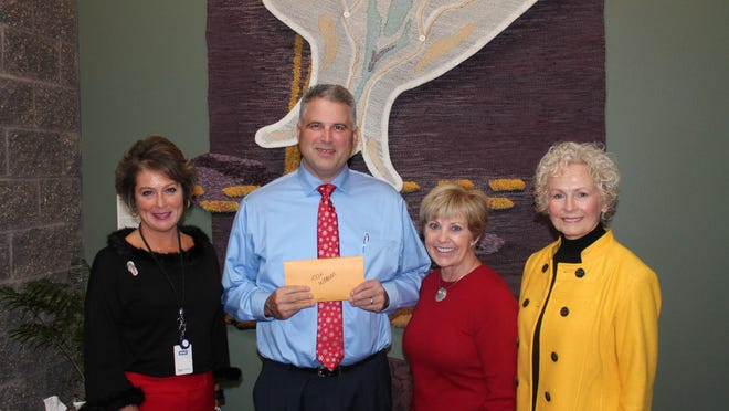 One Hundred Plus Women Who Care group members Leslie Malcom, Deb Milligan and founder Sue Kenny presented Rob Paulus, Kavanagh House team director at HCI Hospice Care Services, a gift of more than $11,000 on Dec. 14. The gift will be used for a variety of purposes, including updates to the Inspiration Room at Kavanagh House on 56th Street. One Hundred Plus Women Who Care is a group of philanthropic women who support Des Moines area charities and nonprofits.