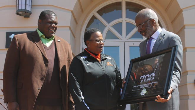 Florida A&M softball coach Veronica Wiggins is honored by Athletic Director Milton Overton Jr. and Interim President Larry Robinson for her 700 career wins.