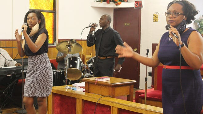 The Pilgrim Rest Church of God in Unity Praise Team led praise and worship Sunday during a service celebrating the accomplishments of students who attend the church. From left are Teah Leggon, Willie Williams and Petrina Adams.