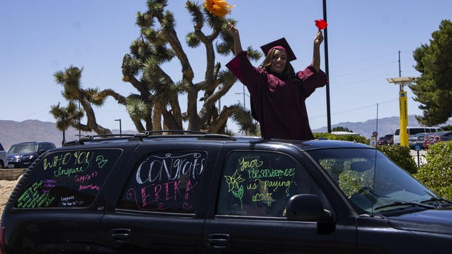 """A Victor Valley College graduate drives up for the college's """"Drive-Thru Celebration"""" on June 13, 2020. Nearly 400 of the 1,500 graduates participated in the event held on the same day as the """"Virtual Commencement Ceremony."""""""