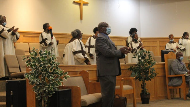 Mount Moriah Baptist Church Choir members, along with Deacon Thomas Herring, center, who presided over the service Sunday morning celebrating the 155th anniversary of Mount Moriah, sing hymns during the service.