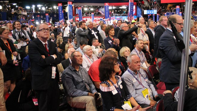 CLEVELAND -- Ohio Gov. Mike DeWine (standing at left) listens with the Ohio delegation as Donald Trump accepts the Republican nomination at the party's convention in July 2016.