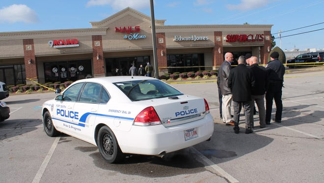 Fort Smith police work the scene of the death of Josh Underwood, 48, on Dec. 31, 2017, outside Supercuts on Zero Street.
