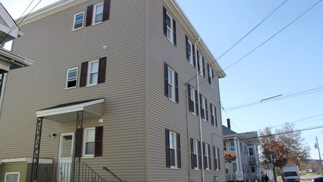 Exterior of 202 Crapo St., a triple-decker building that had several residents relocated to a nearby motel due to a crumbled chimney and cut off gas lines.