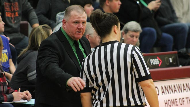 Wethersfield coach Jeff Parsons speaks with a game official on Jan. 24, 2020, in a basketball game at Annawan.