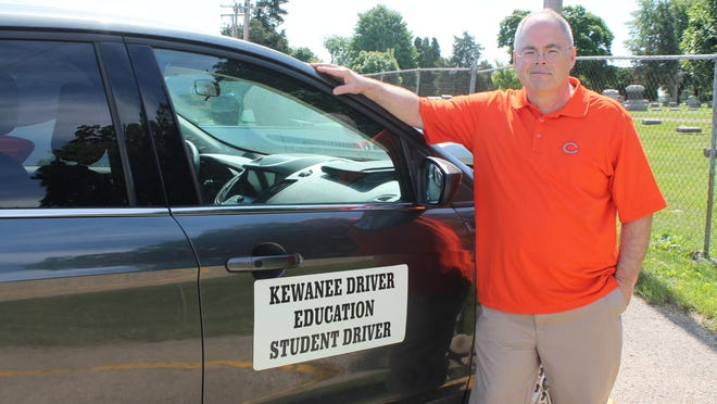 Tim Atwell poses next to a driver's education car on Monday at Kewanee High School. Under Phase 3 of Restore Illinois, on-road instruction of driver's education resumed.