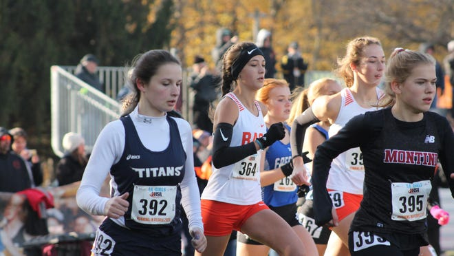 Annawan-Wethersfield's Crystal Musgrave (392) leaves the starting box at the 2019 state cross country meet at Detweiler Park in Peoria. Under new rules released by the IHSA, staggered or wave starts will be the norm as high schools try to conduct sporting events this fall during the coronavirus pandemic.