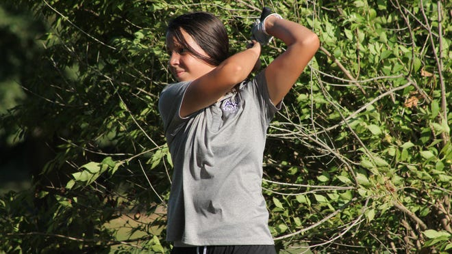 Elizabeth McGill swings for the green from a stand of trees alongside the No. 9 fairway at the Dunes on Thursday.