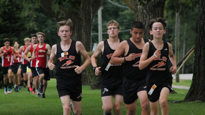 Members of the Kewanee High School cross country team run as a group during a meet this season. Because the regional format is in flights because of restrictions for the pandemic, coaches have had to shift their strategies.