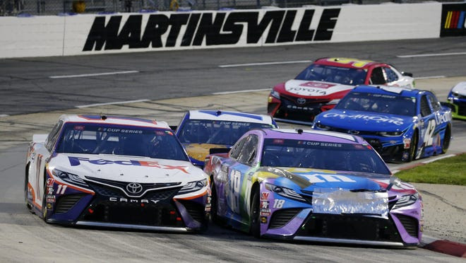 Denny Hamlin (11) and Kyle Busch (18) come through a turn during a NASCAR Cup Series auto race Wednesday, June 10, 2020, in Martinsville, Va.
