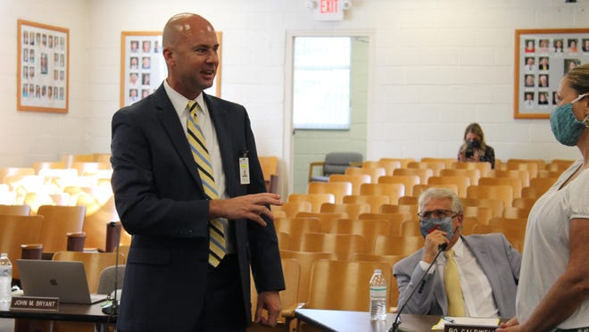 John Bryant speaks at Tuesday's School Board meeting after being named the next superintendent for Henderson County Public Schools.