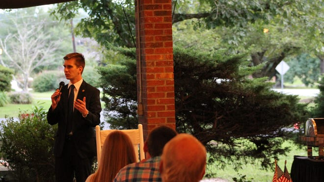 N.C. Rep. Jake Johnson speaks to a crowd Tuesday at Etowah Valley Golf Club and Lodge during a fundraiser.