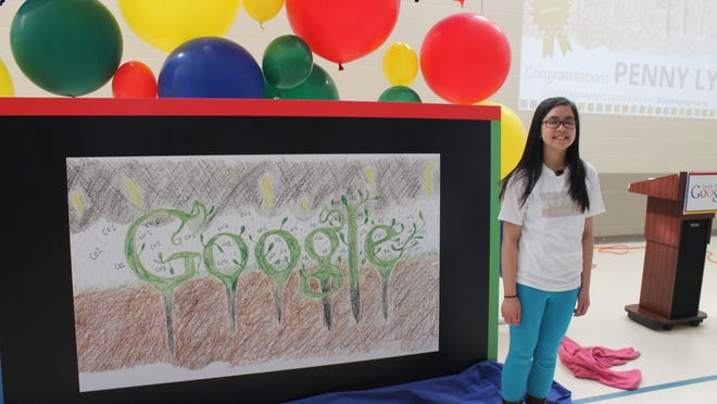 Penny Ly poses with her winning Google Doodle at JFK Elementary School in Winooski, Tuesday.