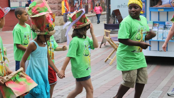 Participants march in the Burlington Cardboard Box Parade on Thursday.
