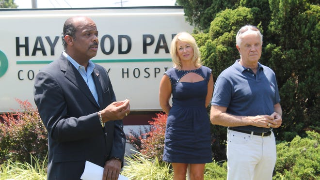 Brownsville Mayor Bill Rawls, left, encourages his community to care for each other after the closing of Haywood Park Community Hospital at a news conference Wednesday hosted by U.S. Senate candidate Gordon Ball, right, and his wife, Happy Hayes Ball.