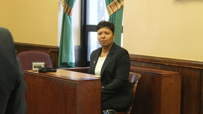 Vatisha Evans-Barken testifies at her hearing Monday before the Madison County Civil Service Commission. Evans-Barken was fired from her job as criminal investigator for the Sheriff's Office last September because of poor attendance.