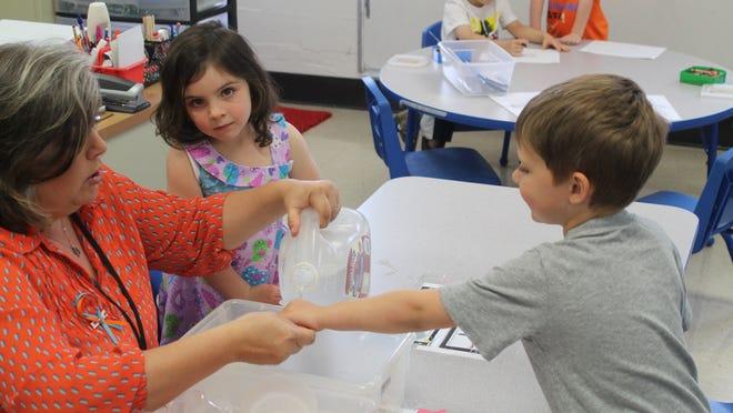 Prekindergarten students do experiments with water in a TRIAD model classroom at Medina Elementary School.