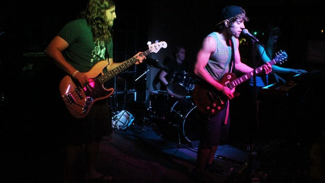 "Derek Henry, 28, Halley ""Ticky"" McCole, 24, Brian Thomas, 25, and Kathleen ""Boopty"" McCole, 27, of the Dubonauts, play live at Bears on Fairfield."