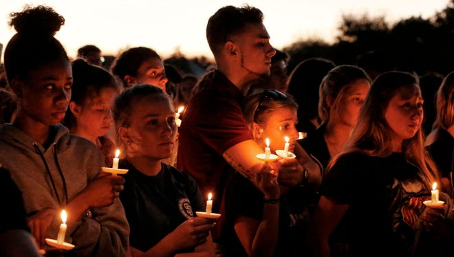 Thousands of mourners attend a candlelight vigil for victims of the Marjory Stoneman Douglas High School shooting in Parkland, Florida on February 15, 2018. A former student, Nikolas Cruz, opened fire at the Florida high school leaving 17 people dead and 15 injured.