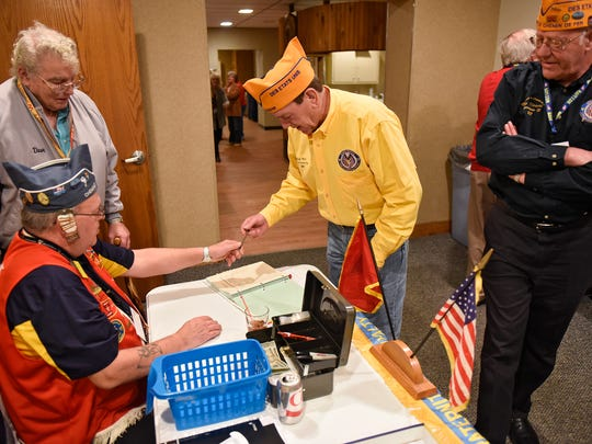 Mark Moots, national commander of the 40&8 veterans group, signs in upon arriving at an event Friday, Jan. 27, at the American Legion Waite park Silver Star Post 428. The 40&8 is an independent, by invitation honor organization committed to charitable and patriotic programs.