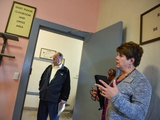 Director of Student Health Services Corie Beckermann and Assistant Vice President for Facilities Management Phillip Moessner talk about planned renovation work in the Eastman Hall building during a tour Thursday, Oct. 5, in St. Cloud.