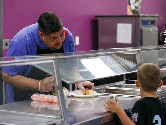 Carlos Gallegos with Sodexo helps distribute free lunches at Leslie Middle School for the Salem-Keizer Public Schools Summer Meals Program on Wednesday, June 20, 2018. The program provides free meals to all children ages 1-18, regardless of family income.
