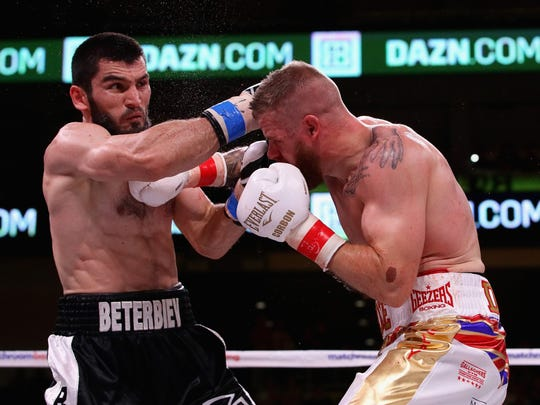 Artur Beterbiev (here trading punches with Callum Jonhson) faces Oleksandr Gvozdyk in a light heavyweight title-unification fight Friday.  Jonathan Daniel / Getty Images