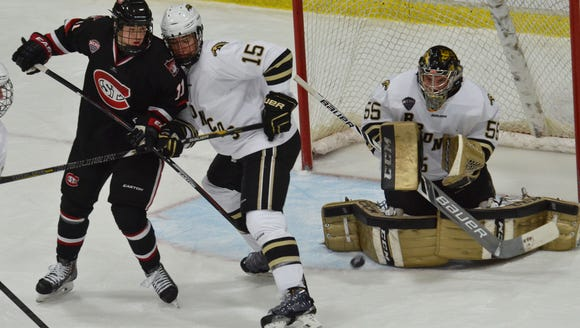 Western Michigan's Lukas Hafner (55) makes a save with
