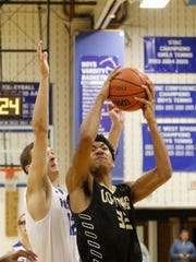 Jon Werner takes the ball to the basket for Corning